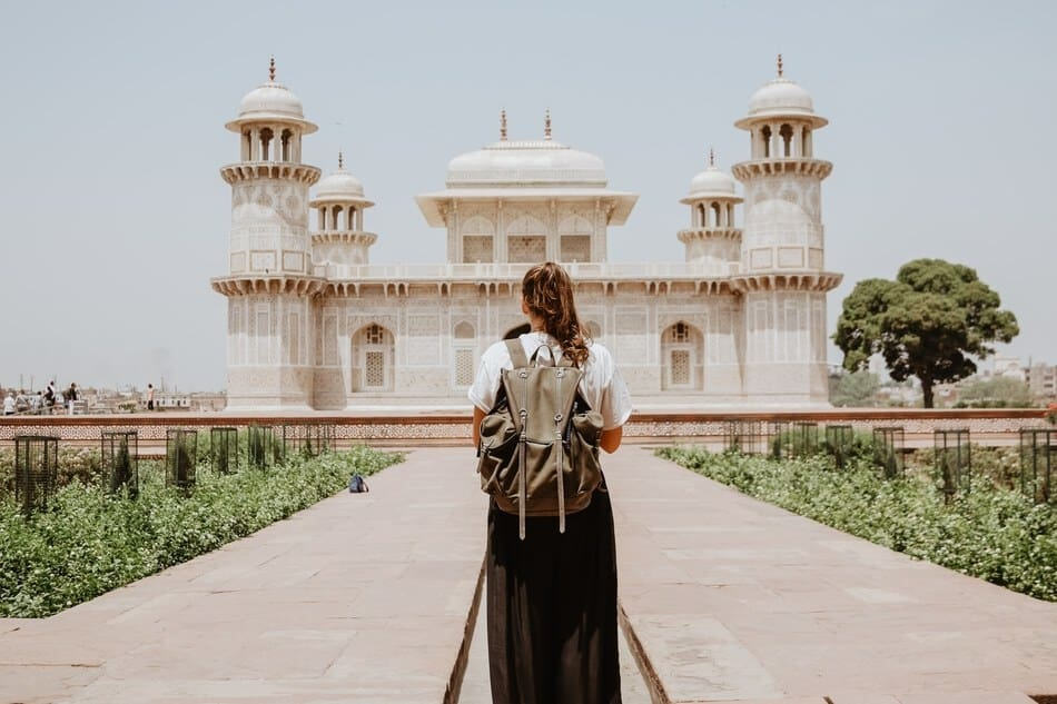 Sarah, One of our town and tourist Solo backpackers heading to a temple in India.