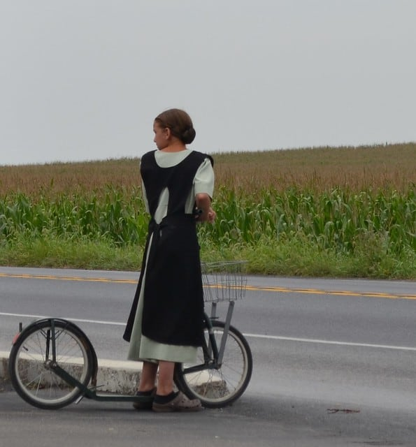 Amish Girl, using traditional transport, Ohio Amish County.