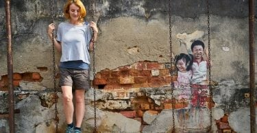 George town street art interacting woman