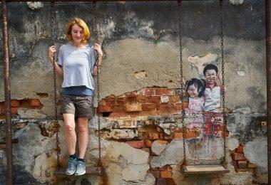 George town street art interacting woman