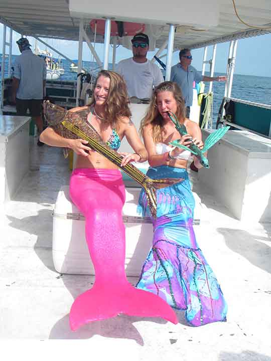 Girls dressed as Mermaids, Aerial at the Keys Underwater Music Festival.