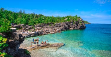 amazing natural rocky beach view and tranquil azure clear water